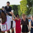 Karim Elzoghby sur Amelia, Rachida Dati et Virginie Coupérie-Eiffel lors du Paris Eiffel Jumping au Champ-de-Mars à Paris, le 5 juillet 2015 dans le cadre du Longines Global Champions Tour