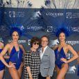 Exclusif - Prix Spécial - No Tabloïd - No Web No Blog - Anne Cassel et Hervé Duperret - Photocall avec les danseuses du Lido lors du Longines Paris Eiffel Jumping au Champ-de-Mars à Paris, le 5 juillet 2015.