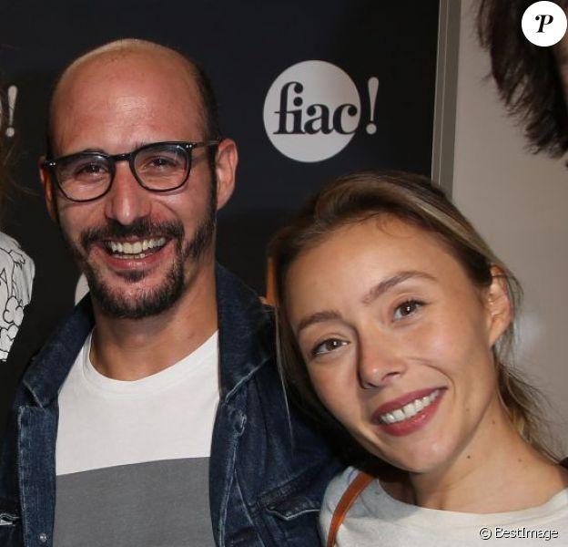 Daphné Bürki et son compagnon Gunther Love, Cartman accompagné de sa petite amie Aurélia Crebessegues et Arnaud Tsamere, au Grand Palais à Paris, le 22 octobre 2014.