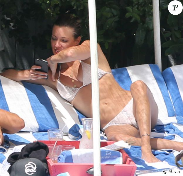 Arrow star Katie Cassidy shows off her toned body as she spends the day with a friend at the hotel pool in Miami Beach, FL, USA on August 08, 2015. Photo by GSI/ABACAPRESS.COM09/08/2015 - Miami Beach