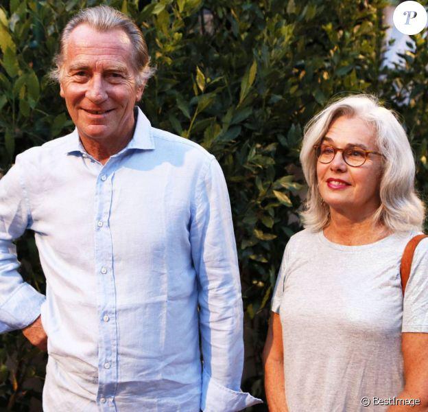 William Leymergie et son épouse à la representation de Julien Clerc dans le cadre du festival de Ramatuelle le 3 août 2013.