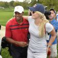 Tiger Woods et Lindsey Vonn lors de la Presidents Cup au Muirfield Village Golf Club de Dublin, aux Etats-Unis le 5 octobre 2013