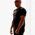 Vin Diesel, victime de body-shaming sur son dad bod (bedaine de papa), s'apprete à répondre. (photo postée le 11 octobre).