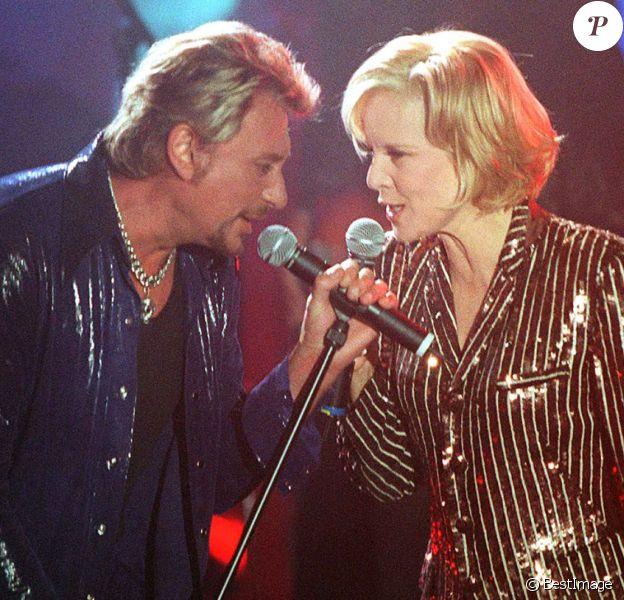 Johnny Hallyday et Sylvie Vartan sur scène en 1998.