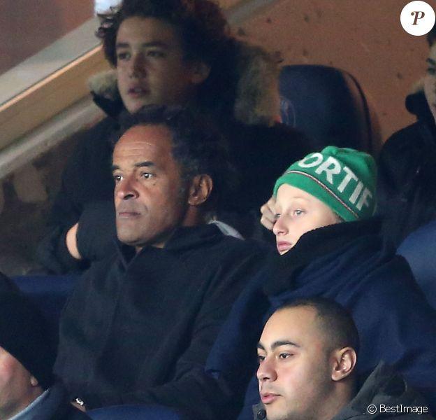 Yannick Noah et son fils Joalukas lors de la rencontre entre le PSG et Chelsea en 8e de finale de la Ligue des champions, au Parc des Princes à Paris le 16 février 2016 © Cyril Moreau