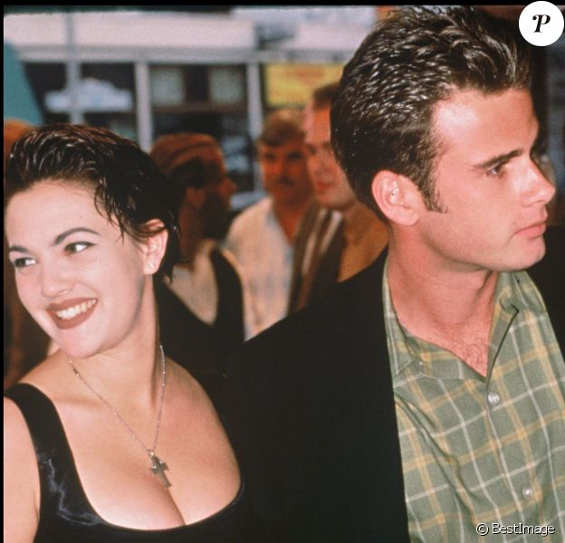 Drew Barrymore et Jamie Walters en 1990