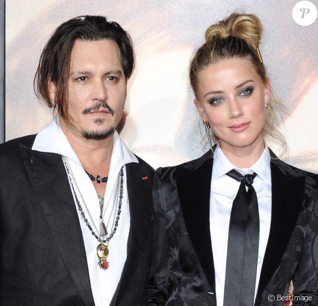 """Johnny Depp et sa femme Amber Heard - Première de """"The Danish Girl"""" au Théatre Westwood Village à Los Angeles le 21 novemnre 2015."""