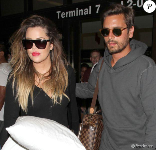 Scott Disick et Khloe Kardashian à l'aéroport LAX de Los Angeles. Le 17 août 2014