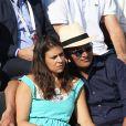 Marion Bartoli et son compagnon (voir vendeurs) très amoureux dans les tribunes lors de la demi-finale des Internationaux de tennis de Roland-Garros à Paris, le 5 juin 2015.