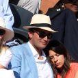 Marion Bartoli et son compagnon dans les tribunes lors de la finale des Internationaux de tennis de Roland-Garros à Paris, le 7 juin 2015.