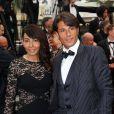Giuseppe et sa compagne Hinda, dans une robe Paule Ka, arrivent au Palais des Festivals pour le film Jimmy's Hall lors du 67e Festival de Cannes, le 22 mai 2014