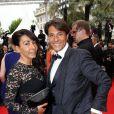 Giuseppe Polimeno et sa compagne Hinda arrivent au Palais des Festivals pour le film Jimmy's Hall lors du 67e Festival de Cannes, le 22 mai 2014
