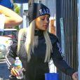 Blac Chyna enceinte et son fiancé Rob Kardashian à la sortie d'un studio d'enregistrement à Los Angeles, le 7 juillet 2016