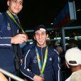 Mathieu Bauderlique et Sofiane Oumiha -Retour à Paris des athlètes français des Jeux olympiques de Rio 2016 à l'aéroport de Roissy le 23 août 2016.
