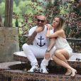 """Christian Audigier et sa belle Nathalie Sorensen lors de la """"Soirée en blanc"""" dans leur ranch de Malibu dans le canyon de Topanga, le 4 mai 2014"""