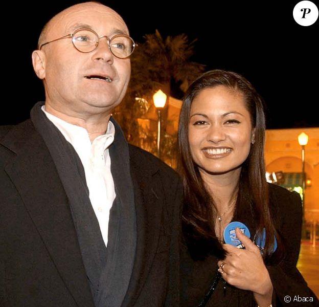 Phil Collins et sa femme au parc Disneyland Paris le 15 mars 2002