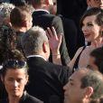 """Luc Besson avec sa femme Virginie Silla et son ex-femme Milla Jovovich (bracelet, boucles d'oreilles et collier Montblanc) à la montée des marches du film """"The Last Face"""" lors du 69ème Festival International du Film de Cannes le 20 mai 2016. © Lionel Urman / Bestimage"""