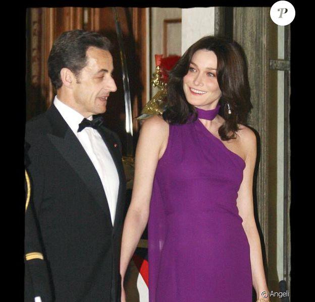 Nicolas Sarkozy et sa femme lors d'un dîner en l'honneur de Shimon Peres à l'Elysée