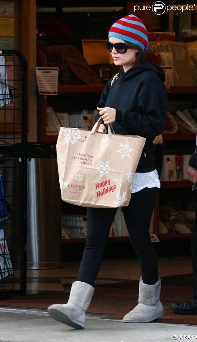 Rachel Bilson sort de son magasin