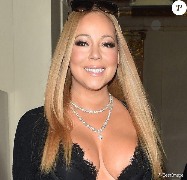 Mariah Carey arrive avec son danseur Brian Tanaka à une réception de mariage à l'hôtel Landmark à Londres le 14 janvier 2017.