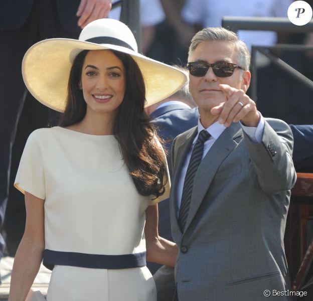 George Clooney et sa femme Amal Alamuddin quittent le palais de Ca Farsetti à Venise, le 29 septembre 2014