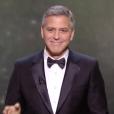 George Clooney reçoit le César d'honneur des mains de Jean Dujardin, sous le regard de sa femme Amal - 24 février 2017