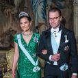 La princesse Victoria (en robe Elie Saab) et le prince Daniel de Suède lors du premier dîner officiel de l'année au palais royal Drottningholm à Stockholm le 23 mars 2017.