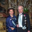 La reine Silvia et le roi Carl XVI Gustaf de Suède lors du premier dîner officiel de l'année au palais royal Drottningholm à Stockholm le 23 mars 2017.