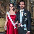 La princesse Sofia, enceinte, et le prince Carl Philip de Suède lors du premier dîner officiel de l'année au palais royal Drottningholm à Stockholm le 23 mars 2017, quelques heures après l'annonce de la naissance prochaine de leur second enfant.