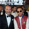 """Remo Ruffini (président et PDG de Moncler) et Lewis Hamilton- Défilé de mode de la fondation """"Fashion for Relief"""" à l'aéroport de Cannes-Mandelieu, en marge du 70e Festival International du Film de Cannes. Cannes, le 21 mai 2017."""
