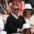 Gérard Holtz et sa femme Muriel Mayette dans les tribunes de Roland-Garros à Paris, le 4 juin 2017. © Dominique Jacovides-Cyril Moreau/Bestimage