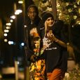 """""""Exclusive - Kylie Jenner and Her new boyfriend Travis Scott show some PDA as they take a walk through a park together before he takes the stage to perform live at the Rolling Loud festival in Miami, Florida. The reality star and the rapper walked with their arms around each other, and their fingers intertwined, as they enjoyed a moment of calm before addressing the massive crowd at the festival, Miami, FL, USa on May 7, 2017. Photo by INSTARimages/ABACAPRESS.COM10/05/2017 - Miamik"""""""