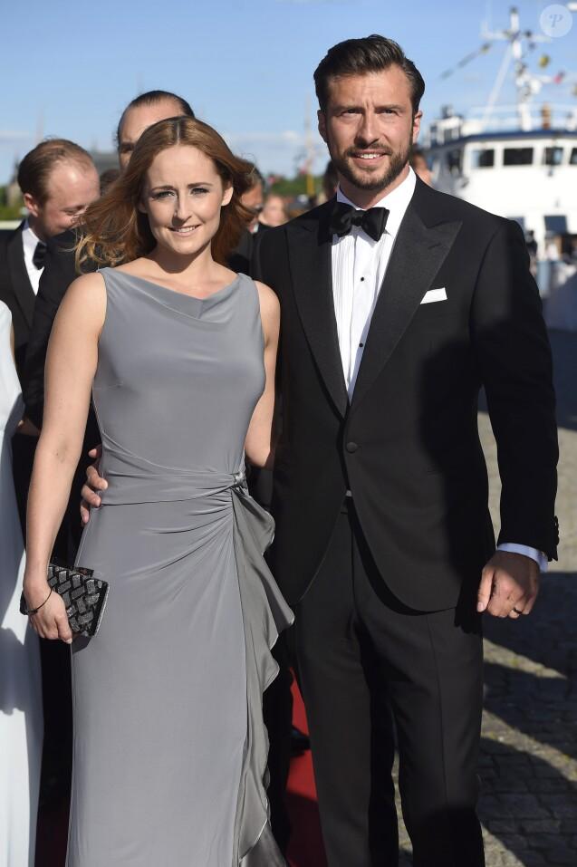 Lina Hellqvist, soeur de la princesse Sofia de Suède, et son compagnon Jonas Frejd lors du dîner de répétition à la veille du mariage de Sofia Hellqvist et du prince Carl Philip de Suède, le 12 juin 2015 à Stockholm.