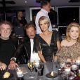 EXCLUSIF - Eddy Mitchelle, Johnny Hallyday, Laeticia et Catherine Deneuve - 67e anniversaire de Johnny Hallyday à Paris, le 15 juin 2010.