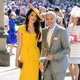 George Clooney et sa femme Amal Clooney arrivent à la chapelle St. George pour le mariage du prince Harry et de Meghan Markle au château de Windsor, Royaume Uni, le 19 mai 2018.