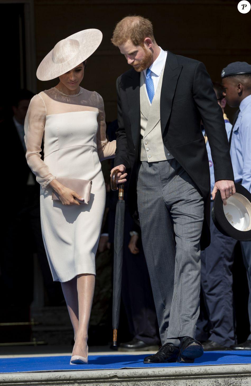 Le prince Harry, duc de Sussex, et Meghan Markle, duchesse de Sussex, à Buckingham Palace le 23 mai 2018 pour une garden party en l'honneur des patronages et associations soutenues par le prince Charles dans le cadre des célébrations de son 70e anniversaire le 14 novembre 2018.