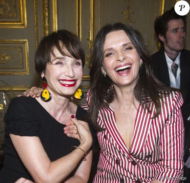Kristin Scott Thomas et Juliette Binoche - Défilé Giorgio Armani Privé, collection Haute Couture automne-hiver 2018/19 à Paris, le 3 juillet 2018.