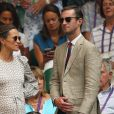 Pippa Middleton, enceinte, et son mari James Matthews au tournoi de Wimbledon à Londres, le 13 juillet 2018.
