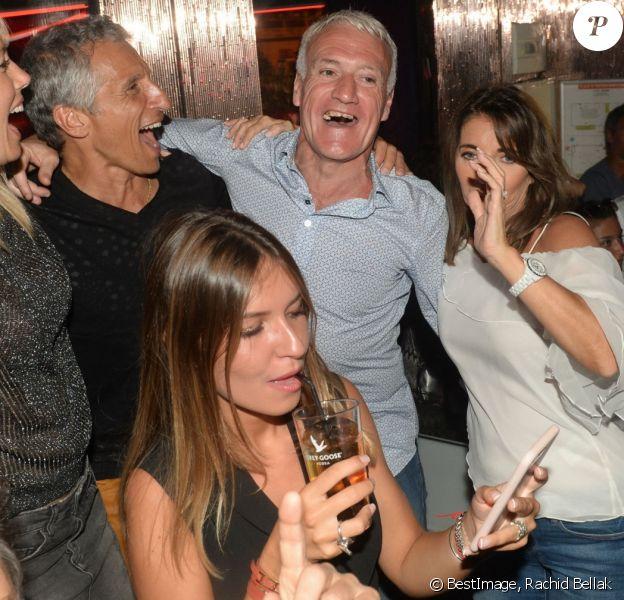 Semi-Exclusif - Didier Deschamps fête sa victoire avec sa femme Claude, Nagui et sa femme Mélanie Page et des amis à la Gioia et au VIP Room à Saint-Tropez, le 21 juillet 2018. © Rachid Bellak/Bestimage