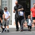 "Exclusif - Kourtney Kardashian emmène ses enfants Mason, Penelope et Reign, déjeuner chez ""Fred Segal"" à Los Angeles, le 4 août 2018. Merci de flouter le visage des enfants avant publication  Exclusive - Germany call for price - A few days after feuding with younger sister Kim over scheduling the family Christmas card shoot, Kourtney Kardashian takes the kids to lunch at Fred Segal in West Hollywood. The eldest Kardashian sib sported a monochrome athletic look in a white cropped tee, and black track pants. She also took to social media to throw some shade of her own at Kim, with a pointed post saying to ""be slow to become angry."" Los Angeles, August 4th, 2018.04/08/2018 - Los Angeles"