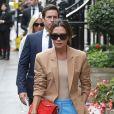 Victoria Beckham à la sortie de son défilé à l'occasion de la Fashion Week de Londres, rejoint sa boutique ou l'attendent sa famille et ses amis, le 16 septembre 2018.