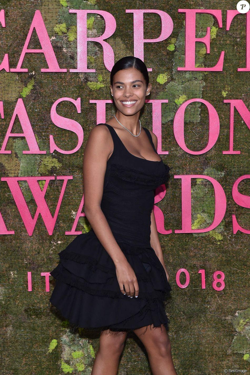 Tina Kunakey lors de la soirée des Green Carpet Fashion Awards au théâtre La Scala à Milan, Italie, le 23 septembre 2018.