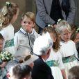 La princesse Charlotte de Cambridge, Savannah Philips, le prince George de Cambridge et Mia Tindall au mariage de la princesse Eugenie d'York et Jack Brooksbank en la chapelle Saint-George au château de Windsor le 12 octobre 2018.