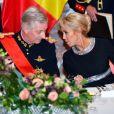 La Première Dame Brigitte Macron et le roi Philippe de Belgique pendant le banquet d'État au château de Laeken à Bruxelles, Belgique, le 19 novembre 2018, lors de la visite d'Etat du couple présidentiel en Belgique.