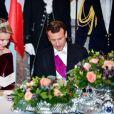Le président de la République française Emmanuel Macron et la reine Mathilde de Belgique pendant le banquet d'État au château de Laeken à Bruxelles, Belgique, le 19 novembre 2018, lors de la visite d'Etat du couple présidentiel en Belgique.