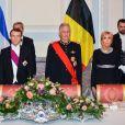 Le président de la République française Emmanuel Macron, sa femme la Première Dame Brigitte Macron, le roi Philippe de Belgique et la reine Mathilde de Belgique pendant le banquet d'État au château de Laeken à Bruxelles, Belgique, le 19 novembre 2018, lors de la visite d'Etat du couple présidentiel en Belgique.