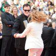 Quentin Tarantino et Mélanie Laurent lors de la montée des marches avant la projection d'Inglourious Basterds, au Festival de Cannes, le 20 mai 2009