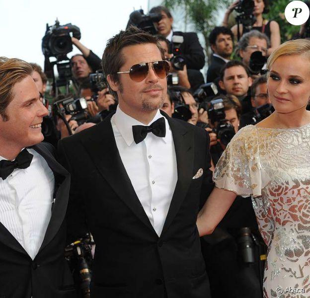 Brad Pitt et Diane Kruger lors de la montée des marches avant la projection d'Inglourious Basterds, au Festival de Cannes, le 20 mai 2009