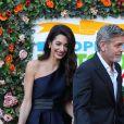 "Amal et George Clooney lors du gala de la loterie caritative ""People's Postcode Lottery"" à Edimbourg le 14 mars 2019"