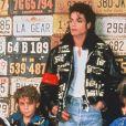 Michael Jackson et Wade Robson (à sa droite), en 1990.